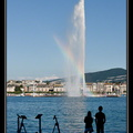 A couple admiring the Foutain of Geneva with its rainbow