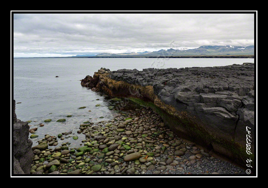 Öndverðarnes - black basalt rocks flowing into the sea, contrasted colors: we feel really be elsewhere